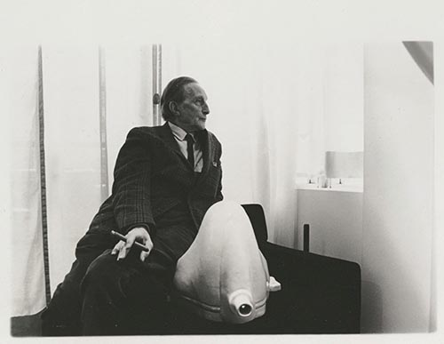 Duchamp Sitting by a Replica of Fountain