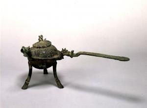 "Image of ""Three legged pot with handle, bronze."""