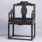 "Image of ""Chair, Carved flower and bat design, Qing dynasty, 18th century (Lent by the Shanghai Museum)"""