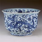 "Image of ""Bowl, Lotus and dragon design in underglaze blue, Jingdezhen ware, China, Ming dynasty, Zhengde era (Lent by the Shanghai Museum)"""