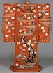 Furisode (Garment with long sleeves), Cherry blossom and stream design on   red chirimen crepe ground Formerly used by Bando Mitsue<br /> Edo period, 19th century (Gift of Ms. Takagi Kiyo)<br /> March 17 - May 17, 2015